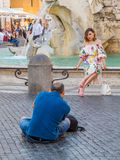 Model posing for photographer in Rome