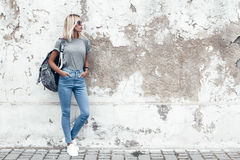 Model posing in plain tshirt against street wall stock images