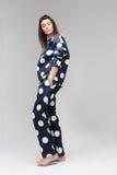 Model posing in a polka dot costume pajamas Royalty Free Stock Photos