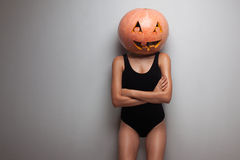 Model posing with pumpkin on head Royalty Free Stock Image