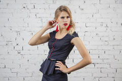 Model posing in sexy teacher suit Royalty Free Stock Image