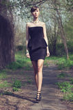 Model posing in short black dress. Brunette model posing in short black dress Royalty Free Stock Photos