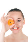 Model posing with slice of juicy orange Stock Photo