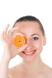 Model posing with slice of juicy orange Stock Photo