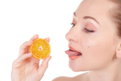 Model posing with slice of juicy orange Royalty Free Stock Image