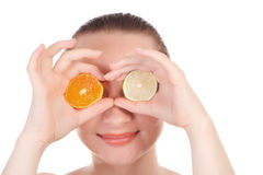 Model posing with slice of orange and lime Royalty Free Stock Images