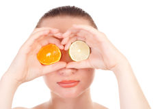 Model posing with slice of orange and lime stock image
