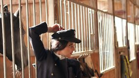 Model posing in the stable on a horse farm. Slow motion. stock video footage