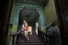 Model posing on the staircase Stock Photo