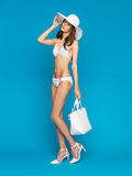 Model posing in swimsuit with hat Royalty Free Stock Photography