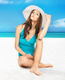 Model posing in swimsuit with hat Royalty Free Stock Photo