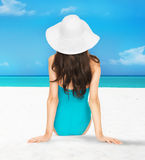 Model posing in swimsuit with hat Stock Images