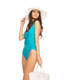 Model posing in swimsuit with hat Royalty Free Stock Image