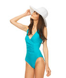 Model posing in swimsuit with hat Royalty Free Stock Images
