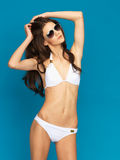 Model posing in white bikini Royalty Free Stock Photography