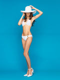 Model posing in white bikini with hat Royalty Free Stock Image
