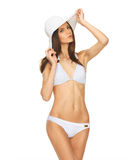 Model posing in white bikini with hat. Picture of model posing in white bikini with hat Royalty Free Stock Photos