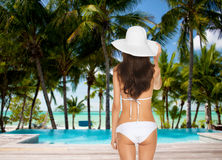 Model posing in white bikini with hat Royalty Free Stock Images