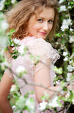Model posing in white flowers Royalty Free Stock Photography