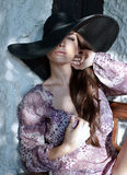 Model posing in wide brimmed hat Royalty Free Stock Photo