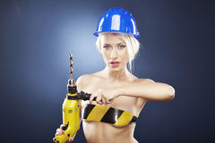 Model with power drill and helmet Royalty Free Stock Photos