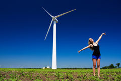 Model and power generator. Model posing in front of wind power generator Stock Photos