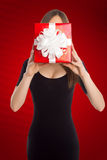 Model with present in front of her face Stock Photos