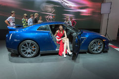 A model presents a car at the Moscow International Motor Show 2012 Royalty Free Stock Photos