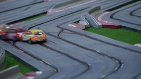 Model race cars on the racing track - Hobby model stock video footage
