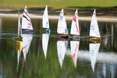 Model radio controlled sailboat regatta race on lake royalty free stock images