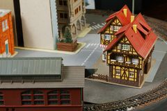 Model railroad on the miniature model scene. Model railroad on the miniature model town scenery represent the transportation and model toy train concept related royalty free stock photos