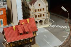 Model railroad on the miniature model scene. Model railroad on the miniature model town scenery represent the transportation and model toy train concept related royalty free stock photo