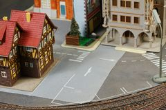 Model railroad on the miniature model scene. Model railroad on the miniature model town scenery represent the transportation and model toy train concept related stock photography