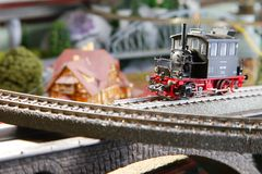 Model railroad on the miniature model town scene. Model railroad on the miniature model town scenery represent the transportation and model toy train concept royalty free stock image