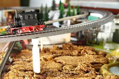 Model railroad on the miniature model town scene. Model railroad on the miniature model town scenery represent the transportation and model toy train concept royalty free stock images