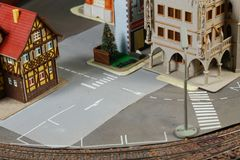 Model railroad on the miniature model scene. Model railroad on the miniature model town scenery represent the transportation and model toy train concept related royalty free stock image