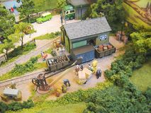 Model Railway Layout, Narrow Gauge. A close up shot of a very detailed model railway layout finished to a high standard, showing kit built wagons and buildings royalty free stock photography