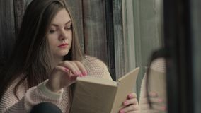 Beautiful young model read a literature turning pages of the book. Model read a literature turning pages of the book stock footage