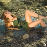 Model reclining in mountain stream Royalty Free Stock Photography