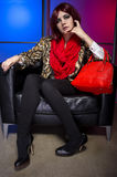Model with Red Bag in a Nightclub Stock Image