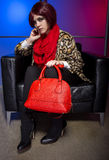 Model with Red Bag in a Nightclub Royalty Free Stock Photo