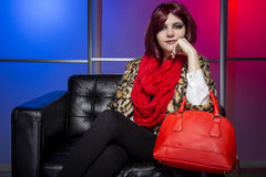 Model with Red Bag in a Nightclub Royalty Free Stock Images