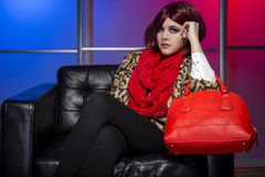 Model with Red Bag in a Nightclub Stock Photography