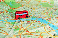 Model of a Red Bus on top of London map Stock Images