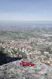 Model of red car and breathtaking panorama Royalty Free Stock Photography