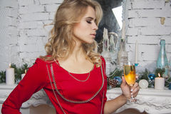 Model in red dress with Christmas champagne Royalty Free Stock Images