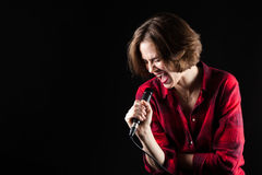 Model Red Flannel Shirt Belting Out Vocals. Black Background Stock Photos