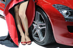 Model and red Mercedes benz sls amg Royalty Free Stock Image