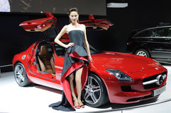 Model and Red Mercedes-Benz SLS AMG car Stock Images
