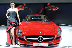 Model and Red Mercedes-Benz SLS AMG car Royalty Free Stock Photography